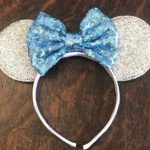 Sparkly silver Mickey ears with blue bow